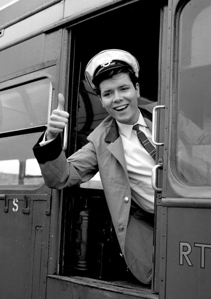 Cliff Richard at the London Transport Driving School, preparing for his role in Summer Holiday.