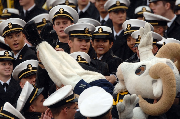 """U.S. Naval Academy mascot """"Bill"""" the goat surfs through the Brigade of Midshipmen during the Air Force-Navy football game. http://www.payscale.com/research/US/School=United_States_Naval_Academy_(USNA)_at_Annapolis/Salary"""