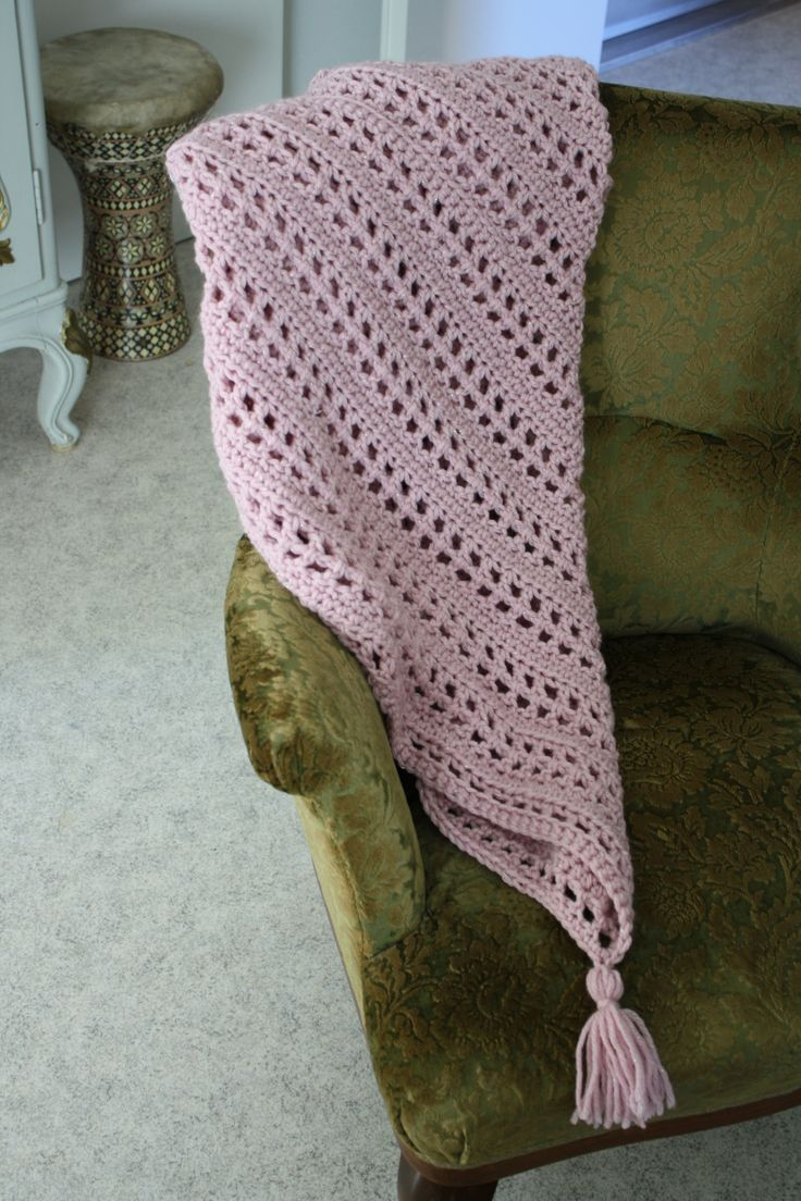 Simple triangle shawl with a pompom.