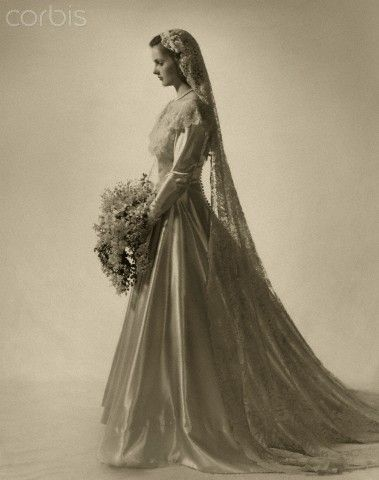 Bride in vintage wedding gown with lace veil Mrs. Harry Havemeyer Webb (formerly Kate de Forest Jennings) wearing her satin wedding dress with wide berth of lace. Stock Photo ID:42-26180621 Date Photographed:May 01, 1947