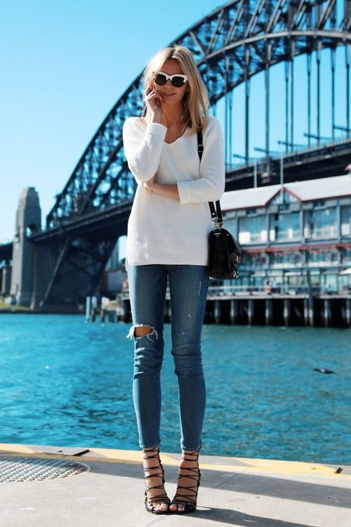 Shop this look for $112:  http://lookastic.com/women/looks/v-neck-sweater-and-skinny-jeans-and-crossbody-bag-and-heeled-sandals-and-sunglasses/3089  — White V-neck Sweater  — Blue Ripped Skinny Jeans  — Black Leather Crossbody Bag  — Black Suede Heeled Sandals  — Black and White Sunglasses