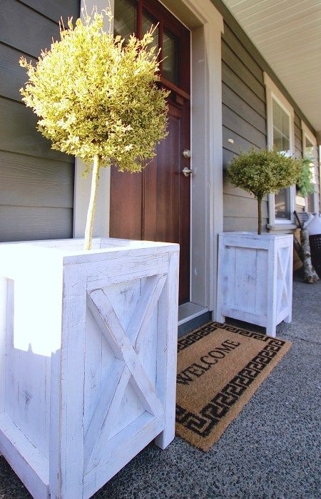 Our Farmhouse Patio Planters for our boxwoods www.theruggedrooster.com