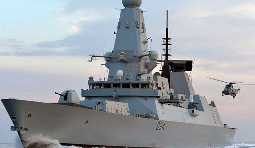 Britain: Type 45 class destroyer HMS Diamond waiting for a Sea King landing.