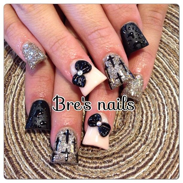 Wide tip nails, black, white, and glitter. With 3d bow accents