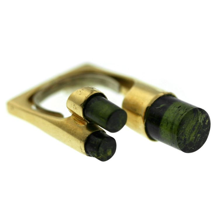 "Jean Vendome Tourmaline Pinky Ring  France  1970s  A unique and beautifully designed ring by Jean Vendome. Cylindrical-shaped green tourmaline stones set in 18k gold form an ""in-between-the-finger-ring. Size 4. Made in France circa 1970s"