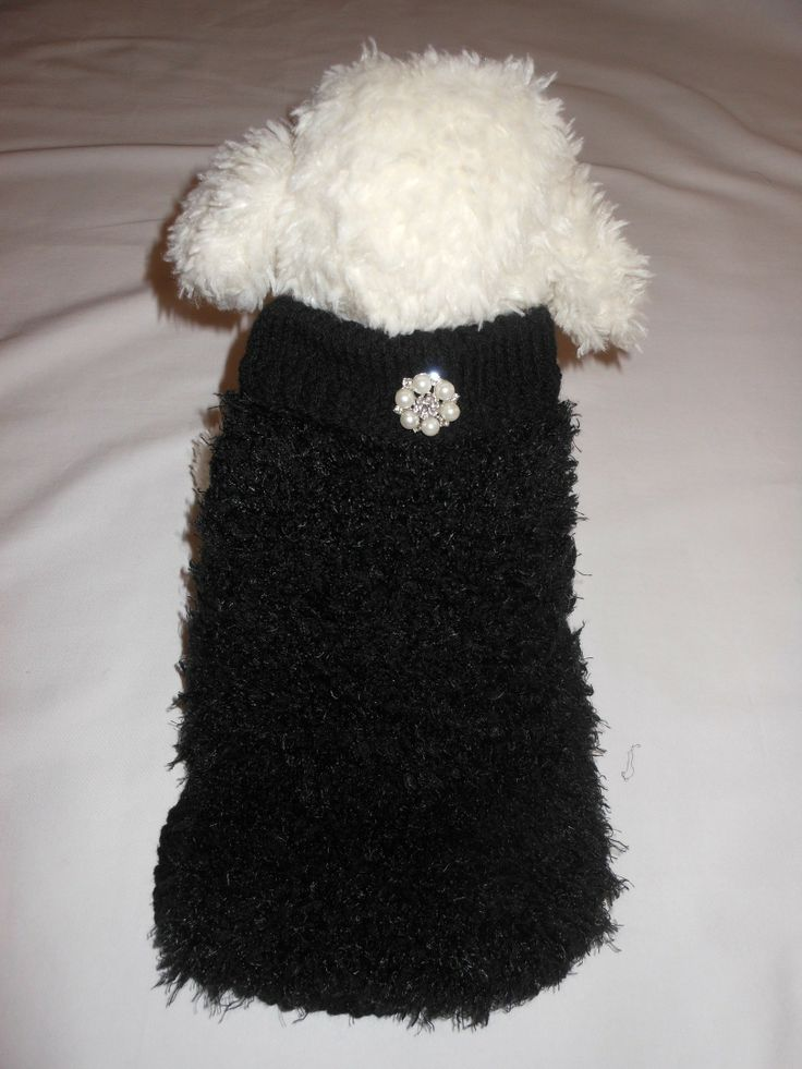 HEPBURN  $49.95 Hepburn is a stunning hand knitted black jumper with a diamante and pearl brooch to make any girl happy. this ultra warm soft fluffy jumper will keep your little one cosy and glamorous