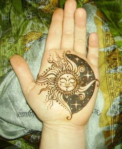 sun moon tattoo.... Not on the hand though
