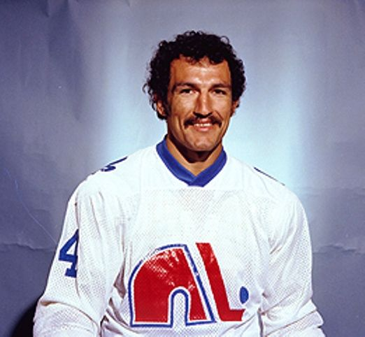 """Gilles Bilodeau had nicknames such as """"Bad News"""" """"Tarzan"""" and """"Zombie"""" Known for his fierce aggressive style of play and fighting ability but he had limited hockey skills. Off the ice he was known to be a gentleman. Unfortunately he passed away in 2008 of undiagnosed pancreatic cancer, he was 53."""