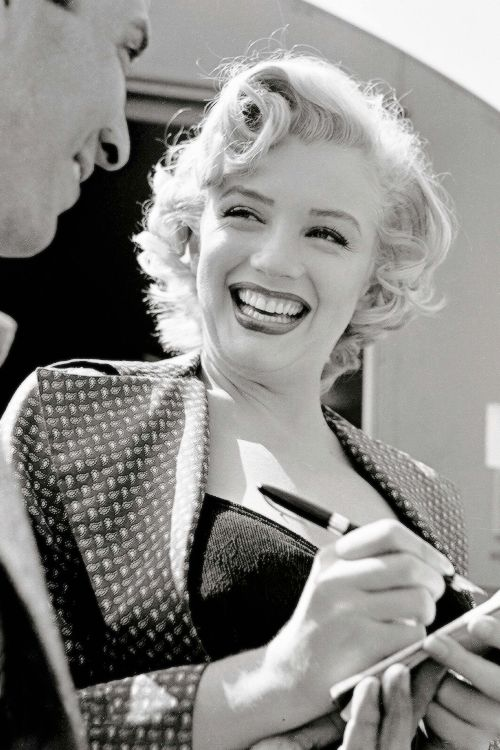 Marilyn Monroe signing an autograph to a fan on the set of, 'Monkey Business' (1952).