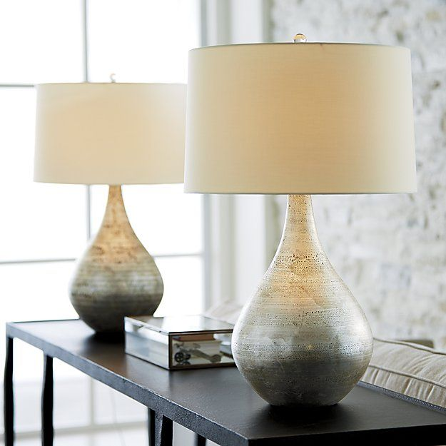 Shop Mulino Table Lamp.  Art glass teardrop wraps its sensuous shape in rich textures, highlighted in silver leaf.  From its cream cotton shade, soft light gilds the lamp in a golden glow.  Topped with a clear glass ball finial for a light, bright accent.