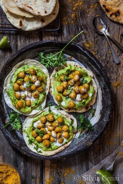 pita bread with spicy masala chickpeas and avocado cream