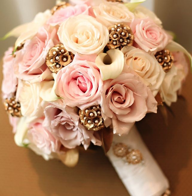 light pink wedding bouquet with pearl pins added in the stiletto pods. gorgeous.