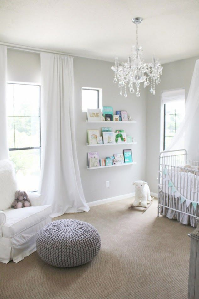 White grey cream nursery, chandelier, crib. The bookshelf is so cute, showing all the different books #interiordesign #nursery #homedecor