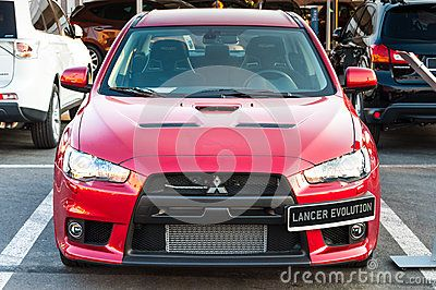 Front view of new modern Mitsubishi Lancer Evolution red car at auto salon.