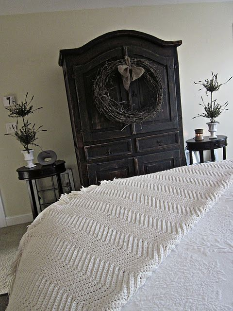 LOVE this black rustic armoire and wreath in this bedroom! By Down to Earth Style