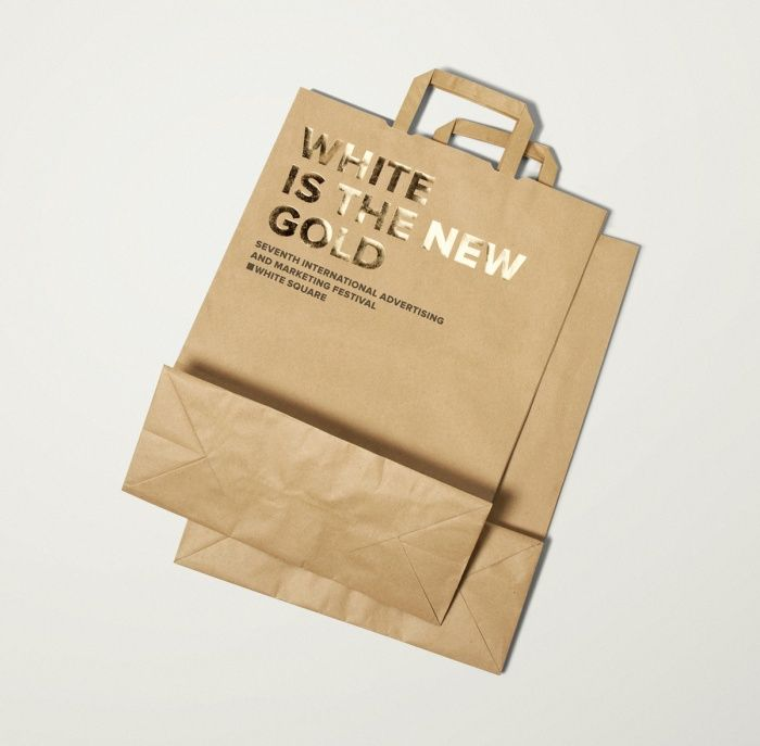 Uncoated and unbleached paper bags with gold foil print finish designed by Tomat.