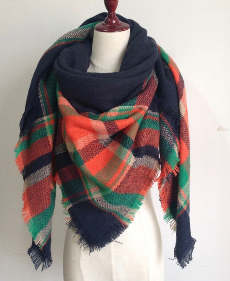 This extra soft scarf is perfect to keep you warm and stylish the whole winter and fall season. This scarf is plaid with orange, black, and green. Size: 55 inches by 55 inches