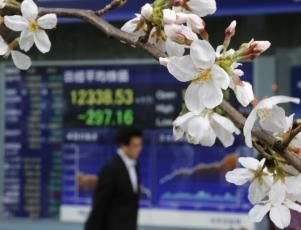 Asia stocks down and dollar on defensive hit by risk aversion