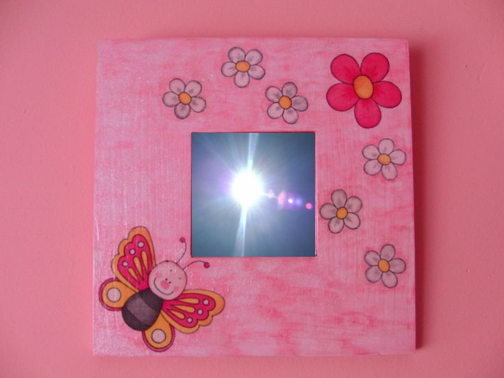 Pink mirror with flowers and butterfly.