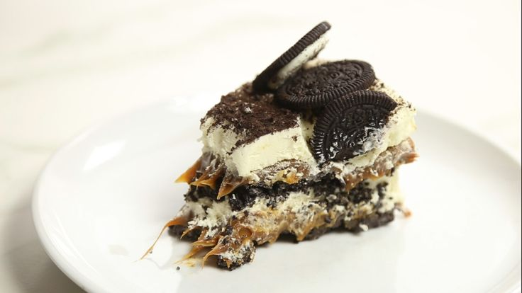 Recipe with video instructions: Kind of like a giant Oreo made out of crushed Oreos. Ingredients: 3 Oreo sleeves, ¼ cup butter, melted, 1 ½ cups dulce de leche, 2 cups whipped cream, To decorate:, ⅓ cup chocolate shavings, 1 Oreo sleeve
