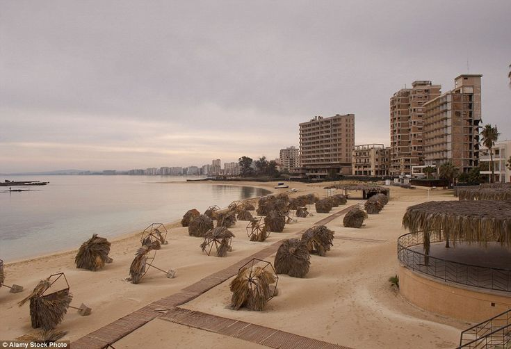 Varosha in Famagusta, Cyprus was once a glamorous beach town graced by film stars such as Elizabeth Taylor and Brigitte Bardot, but is now deserted. It was abandoned when the resort was invaded by Turkish troops in 1974, and today is fenced off and still occupied