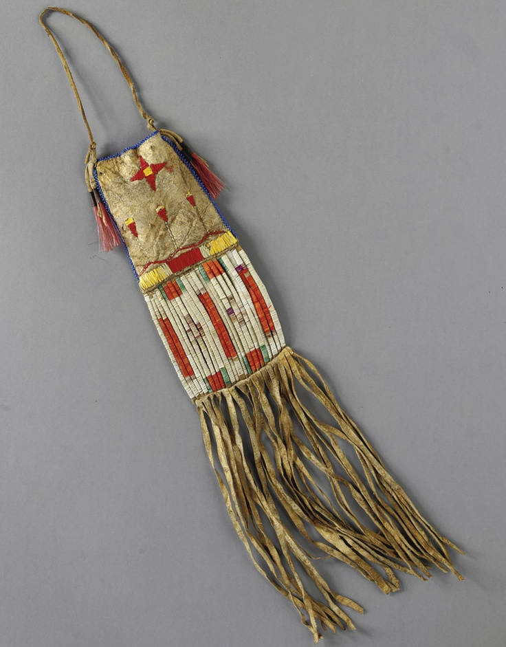 A LAKOTA BEADED AND QUILLED HIDE POUCH    composed of hide, glass beads, cotton thread, porcupine quills, and tin cones inserted with dyed horsehair, with a depiction of a morning star.    Length with fringe 16 in.