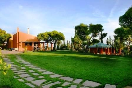 Built in 2005, this superb residence is located on a hill, only a short distance from Marathonas Avenue.  With its own private entrance and landscaped gardens of over 2,500 s.m. the villa enjoys complete privacy and its lawns, shrubs and trees ensure that it remains an oasis of peace and tranquility.