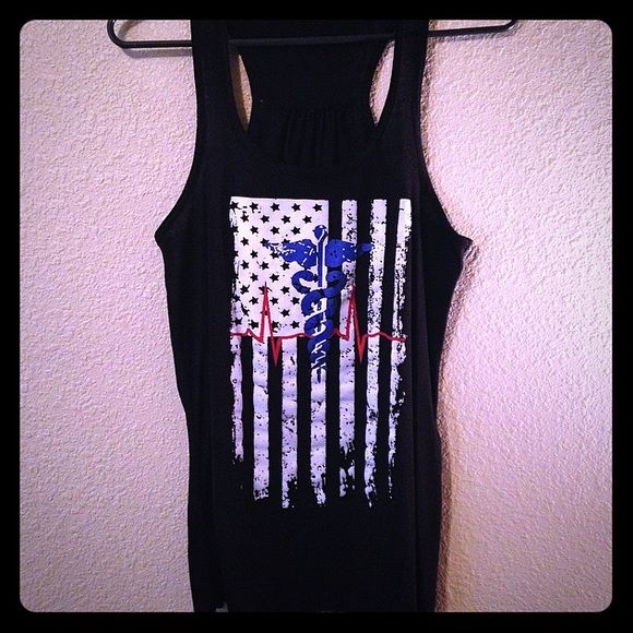Black Patriotic Tank Top with Nursing Symbol GREAT condition; worn once!!   The tag with the size on it was cut out because it was irritating when I wore this shirt.   ✅OFFERS  Trades  Items ship within 24hrs.  OFFER DISCOUNTED BUNDLES If interested in more than 1 item in my closet let me know so I can create a new listing for you at a discounted rate Tops Tank Tops