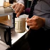 Washington Post Food and Travel Editor Joe Yonan whips up some macaroni and cheese in an NPR mug. Dessert is a brownie-in-a-mug.