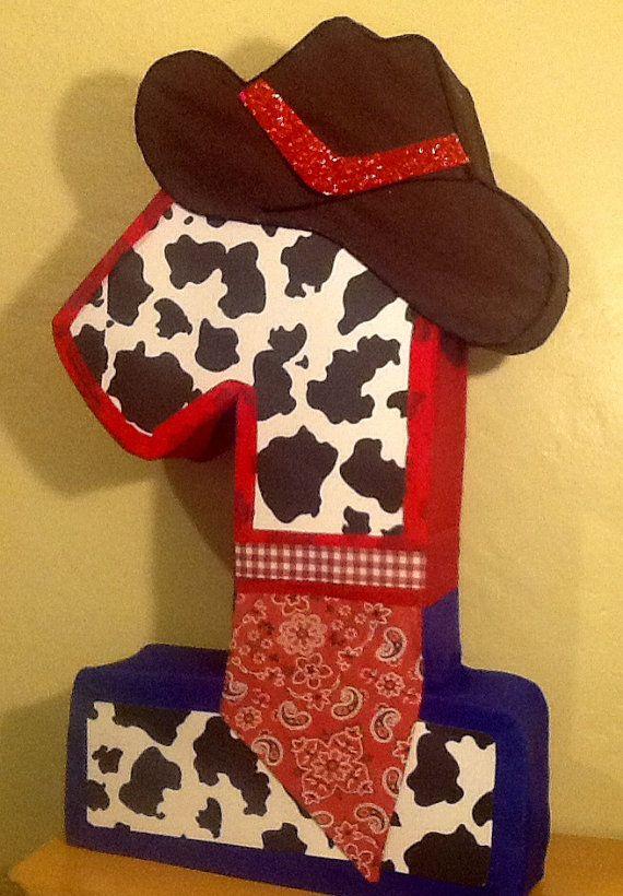 First birthday cowboy pinata. Cowboy party themed. Cowboy