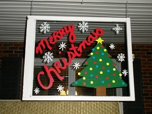 And again! another cheap Christmas decoration. I bought some old windows from the ReStore and painted this. Then hung the window on my front porch. The paint can easily be removed to change the pic. I plan on dointg this for every Holiday and special occasions.