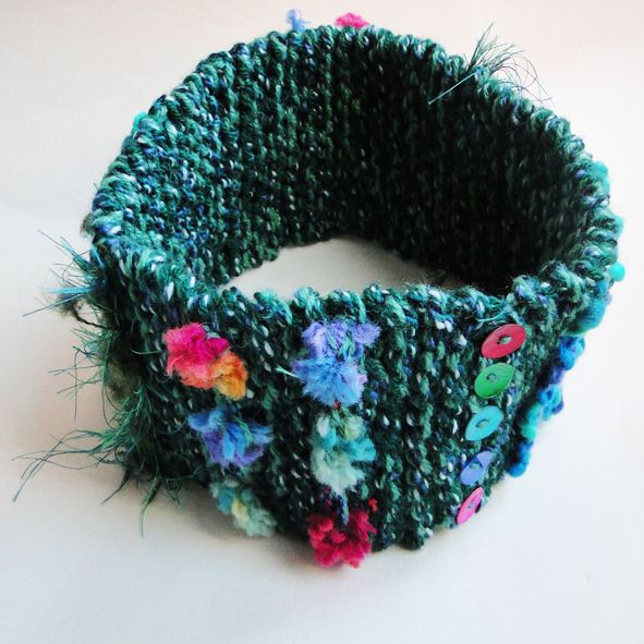 Hand knitted with a variety of rich green colours