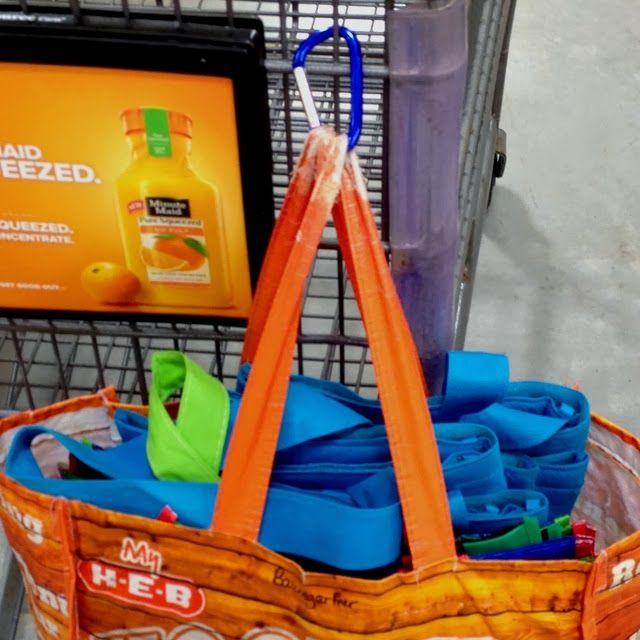 Organize grocery bags on a cart     --    11 Ways to Organize with a Carabiner | OrganizingMadeFun.com