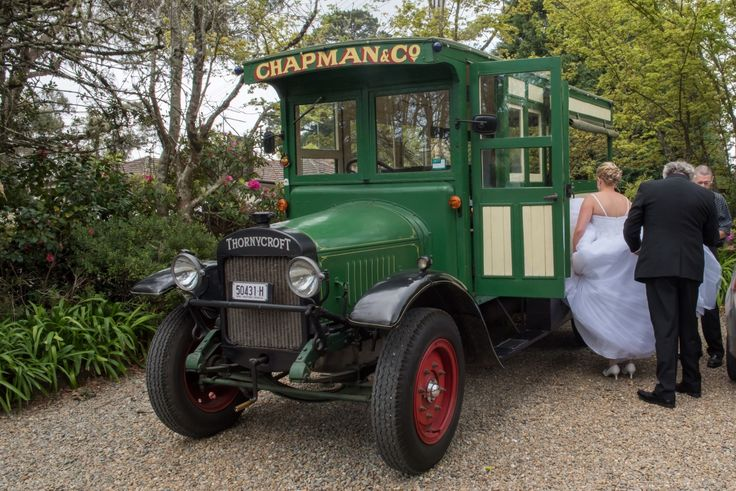 "Wedding Photographer - Candid Photos of a Lifetime  The Bride climbing into her ""trolley car"""