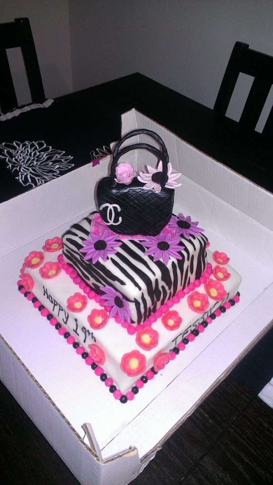 2 tier birthday cake with Zebra print and edible Chanel purse caketopper