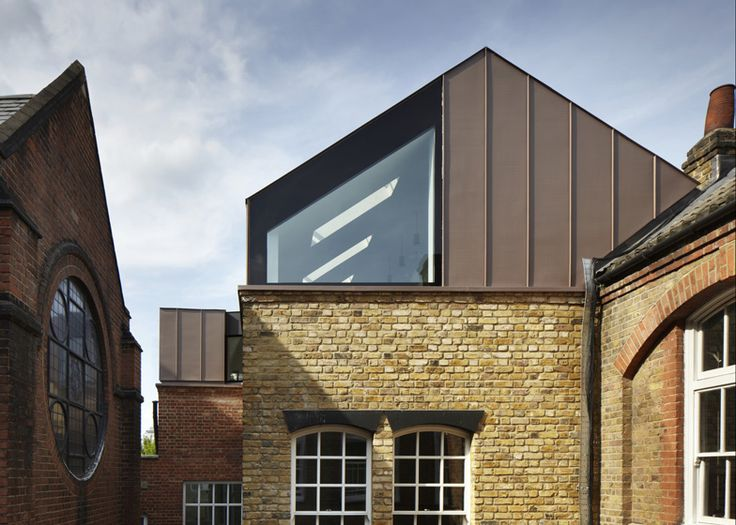 Zinc cladding London-based Studio Webb added the red-zinc extension over the roof of the Victorian primary school in Battersea, creating two extra classrooms on a new second floor.
