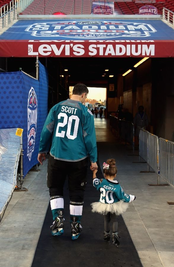 San Jose Sharks forward John Scott walks with one of his daughters at Levi's Stadium (Feb. 20, 2015).