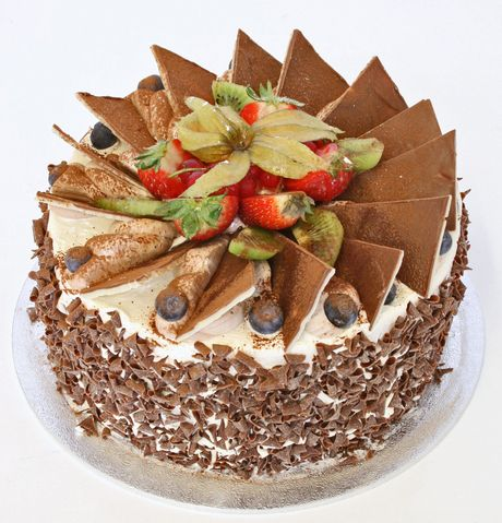 Gateau Ternes: The light, moist sponge filling is split with delicious crème patisserie and milk chocolate curls to the sides. Crisp chocolate triangles decorate the top with market fresh red fruits. It really does taste as light and delicious as it looks.