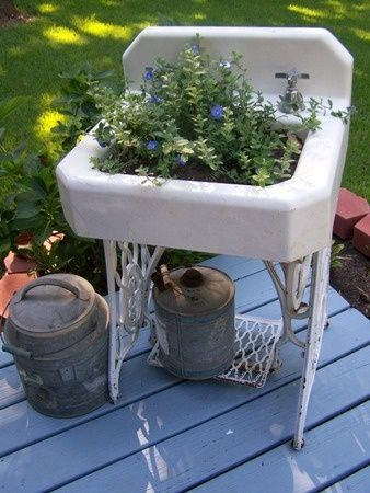 Old sink on sewing machine base is now a unique planter. From Cherry Hill Cottage