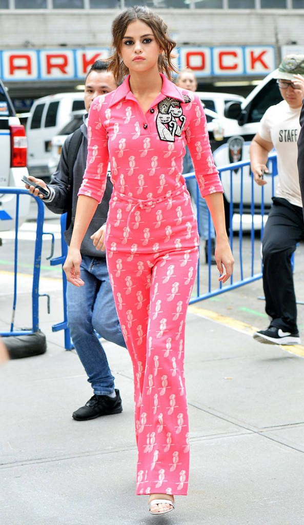 Selena Gomez from The Big Picture: Today's Hot Photos  Meow! The singer looks pretty in a pink catsuit while on her way to Madison Square Garden.