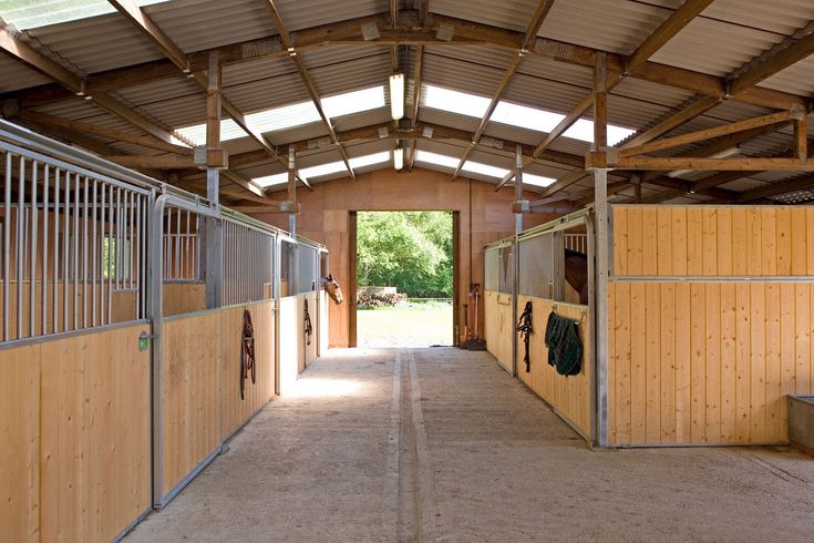 American Barn with five stalls, tack room, feed room and hay stores. Designed and built by The Stable Company for a client in Hampshire, England.