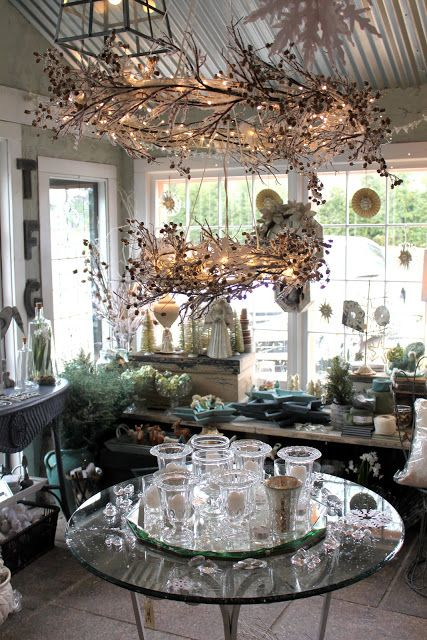 inside boutique taken for granite - via 52 flea blog. HOw about sraypainting that hula hoop hang that with twigs and branches for winter. white. twinkle lights. silver glitter.