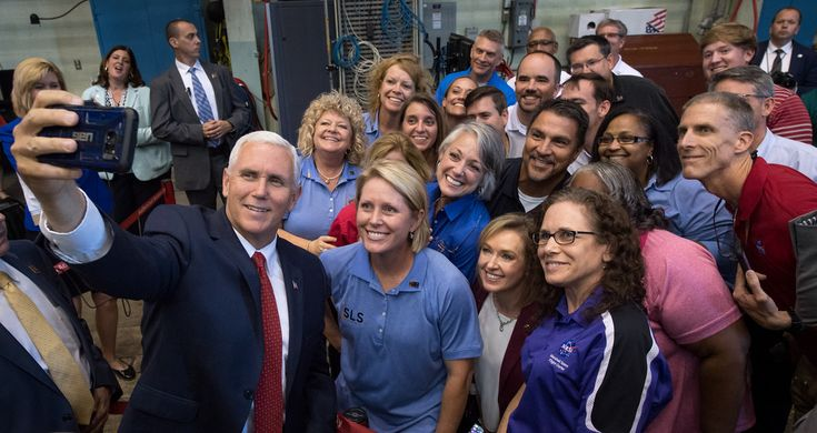 Vice President Mike Pence takes a photograph with employees after having seen the Space Launch System (SLS) structural test, Monday, Sept. 25, 2017 at the NASA Marshall Space Flight Center in Huntsville, Alabama. The Vice President visited the space center to view test hardware for NASA's Space Launch System, America's new deep space rocket and to call the crew onboard the International Space Station. Photo Credit: (NASA/Bill Ingalls)