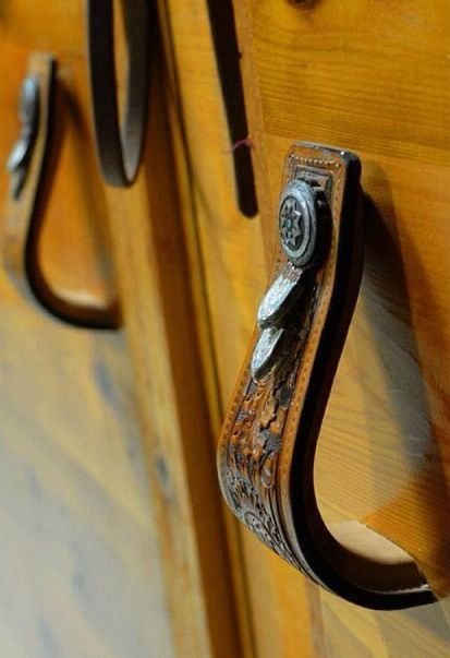 Stirrups for door handles in western decorating. A fun rustic decor DIY project. | Stylish Western Home Decorating
