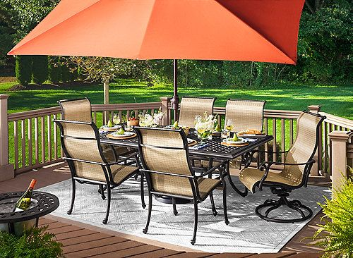 Dine outdoors in style with the Moreaux 7-piece outdoor dining set. Its cast aluminum table has the beautiful look of wrought iron yet is lighter in weight as well as corrosion-resistant for durability through the seasons. Swivel and stationary sling chairs add timeless transitional style to the set while providing a more casual look and feel.  And with seating for 6, the set is ideal for both family dinners and entertaining. Add a table umbrella with base to your set for protection on sunny…