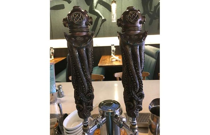 Sidle up to the bar and request a pint of the rotating selection of brews flowing from one of these ... - Courtesy of Blue Oyster Bar/Shane Witt