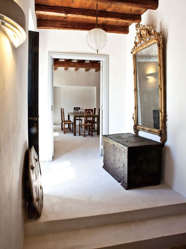 funky mix of modern & antique in a hallway. Why not make the passageways in your home as unique as possible?