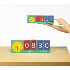 Use this freestanding flip chart to teach telling the time. The clock face has moveable colour-coded hands, making it easy for children to co-ordinate the hands on the clock face and the time on the flip chart.  Curriculum Links  Handy for the new curriculum  •Comparative time (Y1)  •Compare and sequence intervals of time (Y2)  •Tell the time in analogue, Roman numerals and 24hr clock (Y3)  •Convert seconds, minutes and hours (Y4)