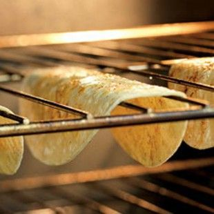 How to Make Crispy Taco Shells in the Oven: ALWAYS ALWAYS PUT COOKIE SHEET UNDER RACK TO CATCH A BROKEN CRISPS