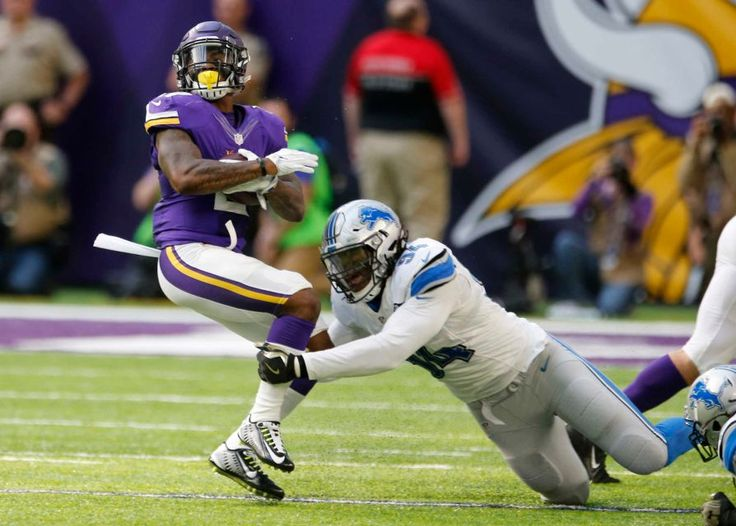 Lions vs. Vikings:  22-16, Lions  -  November 6, 2016  -     Minnesota Vikings running back Jerick McKinnon, left, is tackled by Detroit Lions defensive end Ezekiel Ansah, right, during the first half of an NFL football game, Sunday, Nov. 6, 2016, in Minneapolis.